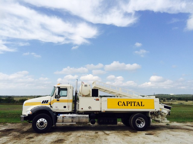 Concrete trailer pumps and city pumps used by Capital Concrete Pumping for line pumping projects